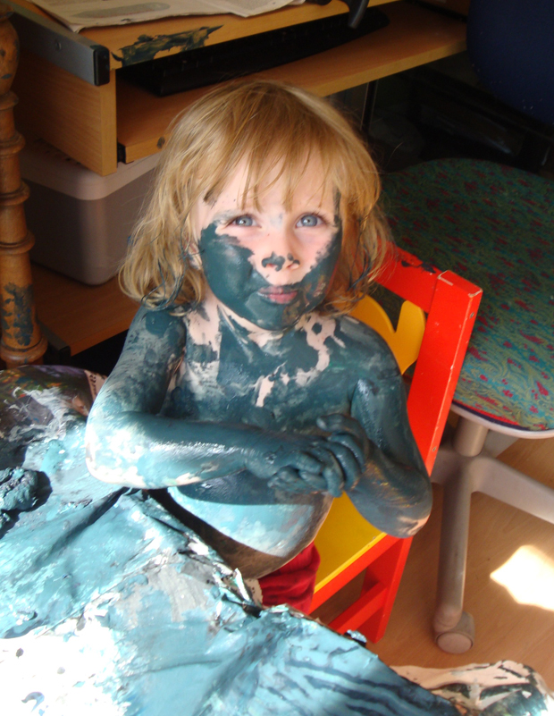 crafty children covered in paint